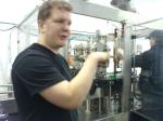 Brewmaster Graham With showing us the canning machine